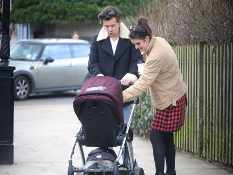 Harry Styles dotes on friend's baby as he indulges his broody side on day out in London