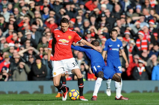 Manchester United's Nemanja Matic, left, challenges for the ball with Chelsea's N'Golo Kante during the English Premier League soccer match between Manchester United and Chelsea at the Old Trafford stadium in Manchester, England, Sunday, Feb. 25, 2018. (AP Photo/Rui Vieira)