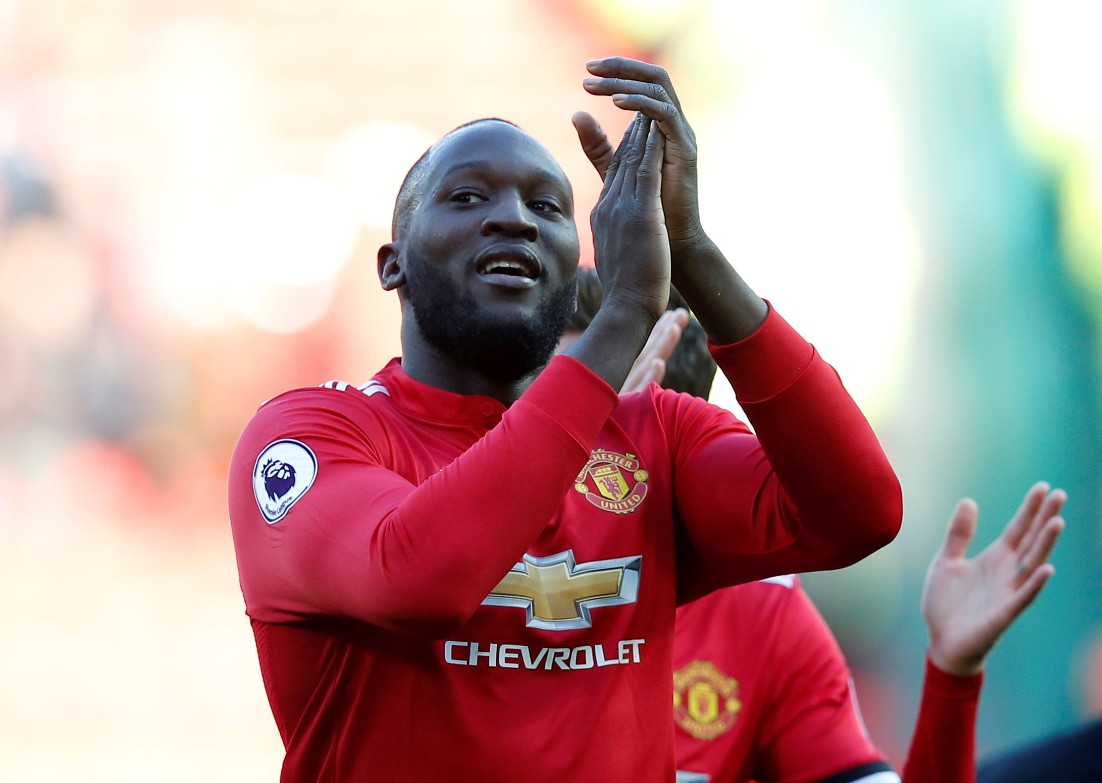 "Soccer Football - Premier League - Manchester United vs Chelsea - Old Trafford, Manchester, Britain - February 25, 2018 Manchester United's Romelu Lukaku applauds the fans after the match REUTERS/Andrew Yates EDITORIAL USE ONLY. No use with unauthorized audio, video, data, fixture lists, club/league logos or ""live"" services. Online in-match use limited to 75 images, no video emulation. No use in betting, games or single club/league/player publications. Please contact your account representative for further details."