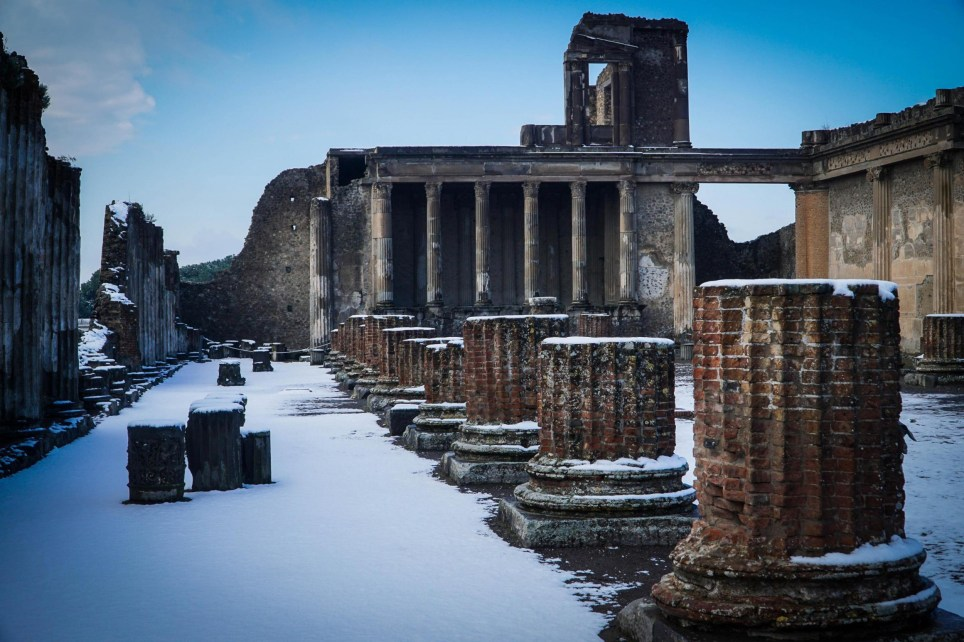epa06568282 The excavation site in Pompei is covered with snow after a snowfall, in Pompei near Naples, Italy, 27 February 2018. Media reports state that extreme cold weather is forecast to hit many parts of Europe with temperatures plummeting to a possible ten year low. EPA/CESARE ABBATE