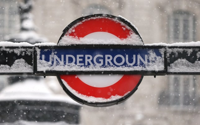 Snow settles on a London underground sign outside Piccadilly Circus tube station, as heavy snow and sub-zero conditions have blighted Britain's roads, railways and airports, with delays and cancellations. PRESS ASSOCIATION Photo. Picture date: Wednesday February 28, 2018. See PA story WEATHER Snow. Photo credit should read: Jonathan Brady/PA Wire