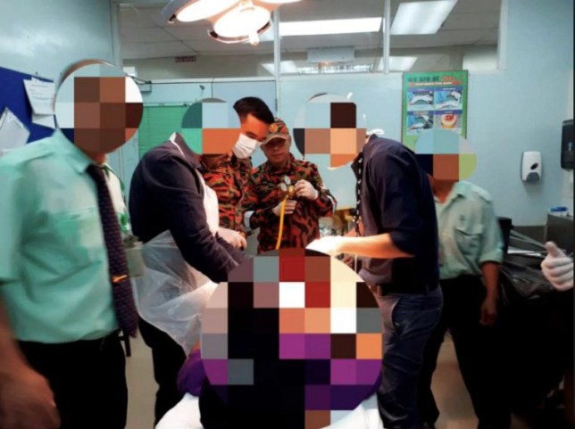 Man with ring and a pair of scissors stuck to his penis rushed to hospital Credit: Sarawak Fire and Rescue Services Department