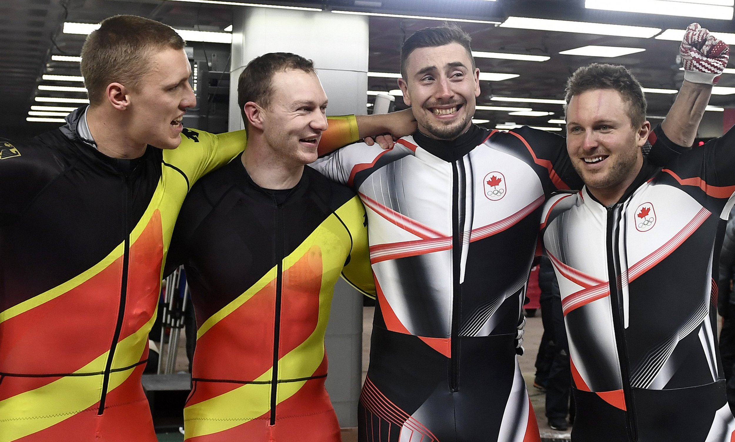 Canada's bobsleigh team thought the Germans were just pleased for them after gold medal dead heat at the Winter Olympics