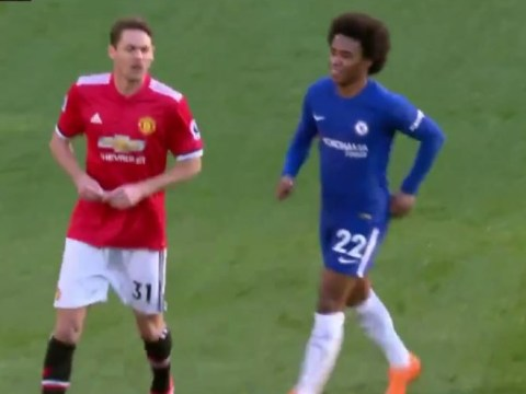Willian attempts to read Mourinho's note to Nemanja Matic in Manchester United's win over Chelsea