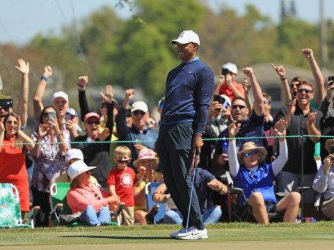 Tiger Woods reacts to his mental 71-foot putt at the Arnold Palmer Invitational