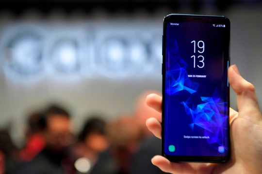 A woman holds a new Samsung Galaxy S9 mobilephone during the Samsung Galaxy S9 Unpacked event on February 25, 2018 in Barcelona, on the eve of the inauguration of the Mobile World Congress (MWC). The Mobile World Congress, the world's biggest mobile fair, is held in Barcelona from February 26 to March 1. / AFP PHOTO / LLUIS GENELLUIS GENE/AFP/Getty Images