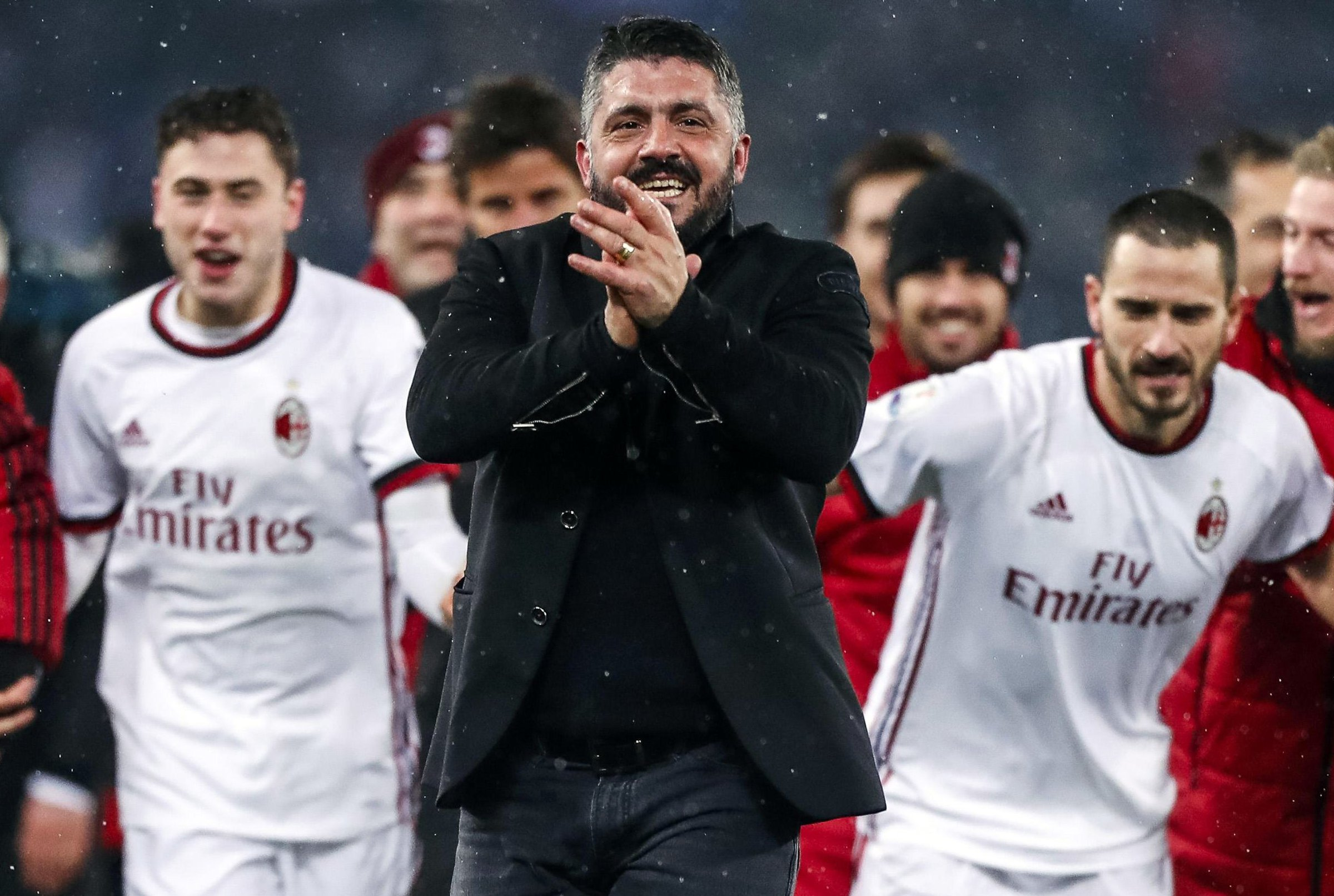 AC Milan coach Gennaro Gattuso celebrates with players after winning the Italian Cup, second-leg semifinal soccer match between Lazio and AC Milan, at the Rome Olympic stadium Wednesday, Feb. 28, 2018. AC Milan won 5-4 following a penalty shootout and advances to the final where it plays Juventus. (Angelo Carconi/ANSA via AP)