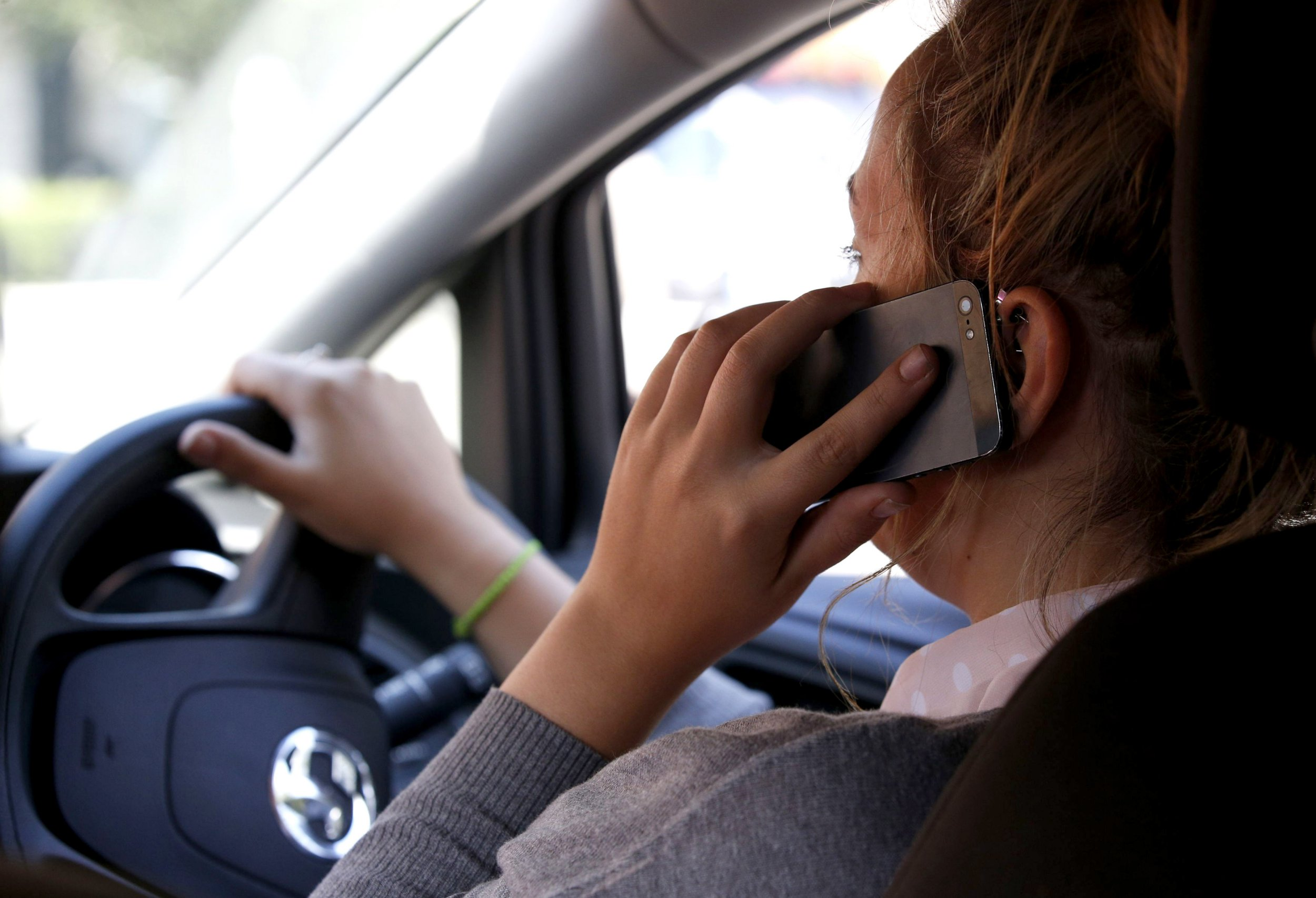 POSED BY MODEL File photo dated 13/08/14 of a woman using a mobile phone at the car wheel, as police data has shown that the number of motorists caught using a mobile phone illegally has almost halved since penalties for offenders were doubled. PRESS ASSOCIATION Photo. Issue date: Thursday March 1, 2018. The new figures suggest that around 39,000 fixed penalty notices (FPNs) were issued to drivers between March and December last year compared with 74,000 during the same period in 2016. See PA story TRANSPORT Mobiles. Photo credit should read: Jonathan Brady/PA Wire