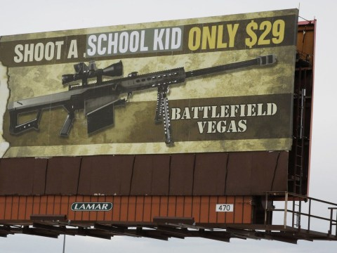 Vandalised billboard advertises shooting a school kid for $29