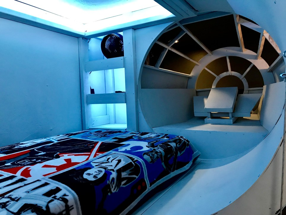 A mum and dad from Oklahoma have created the ultimate Star Wars pad for their young son in a bid to encourage him to sleep in his own room. Derick and Kendra Winsett recently posted pictures from the ambitious project on their Reddit page, and as you can imagine the results received the thumbs up from sci-fans worldwide. The couple built the sleeping pod, which is suspended five feet from the floor and modelled on the Millennium Falcon, for Mavrick, 5, because he always wanted to be in his parent???s room. Ten feet in length and five feet in width the pod comfortably features a twin-sized bed and is fitted with colour-changing lights and a fan for air circulation. There are even NERF guns and lightsabres on hand to ward off enemy resistance during the night. The Star Wars-themed bedroom has another clever touch. Because it???d be nearly impossible to recreate the entire Millenium Falcon in a room that size, Dericrw and his wife opted to build just one part of the ship. They then bolted it to the ceiling joists and lined it up with a vinyl mural of the ship that covers the entire wall. The result looks like the whole ship is about to emerge from the wall and fly into hyperspace. So, is Mavrick now sleeping in his own room? ???Our son is finally sleeping in his own bed!???, Derick tells Cover Images. ???Now to get our younger daughter to do the same! ???He used to never leave our room and our Bedroom TV ran the Disney channel 24/7. ???Now he can???t wait to go to his room at night. Win for both teams!??? Featuring: Atmosphere Where: Oklahoma, Oklahoma, United States When: 05 Mar 2018 Credit: Derick Winsett/Cover Images **All usages and enquiries, please contact info@cover-images.com - +44 (0)20 3397 3000EDITORIAL USE ONLY. IMAGES ONLY TO BE USED IN CONJUNCTION WITH EDITORIAL STORY. IMAGE COPYRIGHT REMAINS WITH THE PHOTOGRAPHER AND/OR SUPPLIER.**