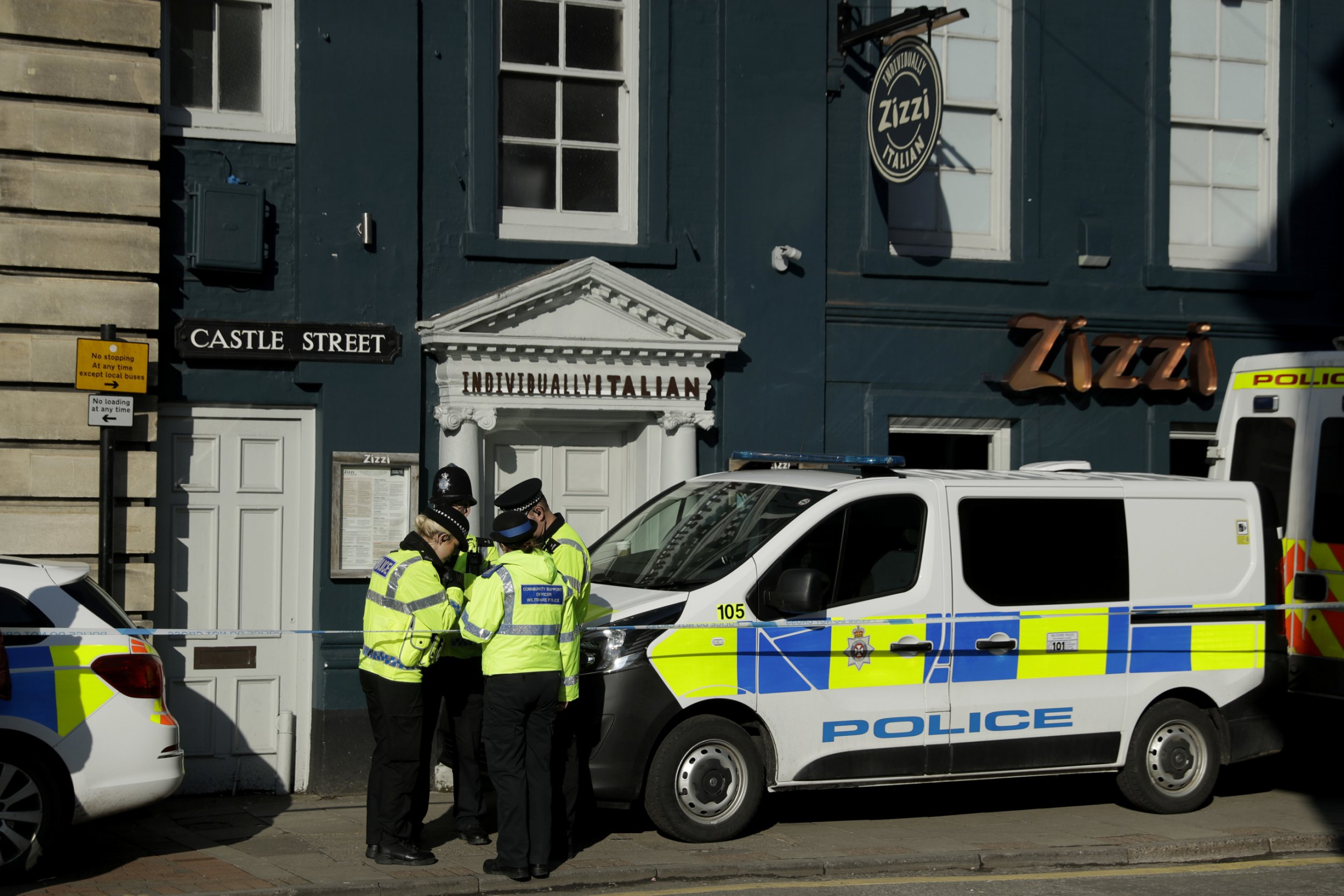 "Police officers stand outside a Zizzi restaurant in Salisbury, England, Wednesday, March 7, 2018, near to where former Russian double agent Sergei Skripal was found critically ill. Britain's counterterrorism police took over an investigation Tuesday into the mysterious collapse of the former spy and his daughter, now fighting for their lives. The government pledged a ""robust"" response if suspicions of Russian state involvement are proven. Sergei Skripal and his daughter are in a critical condition after collapsing in the English city of Salisbury on Sunday. (AP Photo/Matt Dunham)"