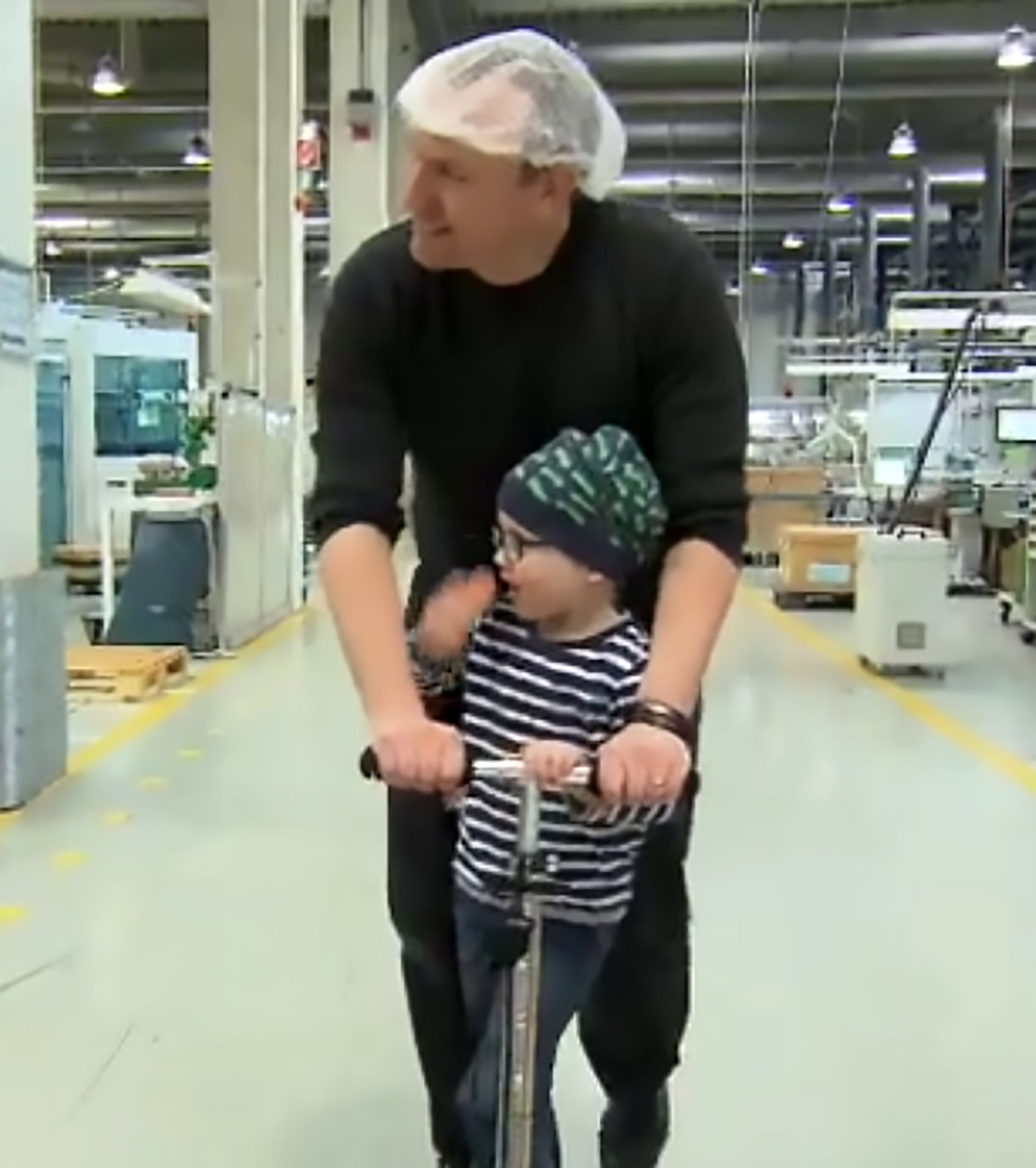 """Pics shows: Andreas Graf shows his son Julius around the assembly plant where he works; A dad's colleagues have donated nearly 3,300 hours of overtime so he could be by his young son's bedside as he fought leukaemia following the sudden death of the boy's mum. Little Julius was just three years old when he was diagnosed with leukaemia and his treatment kept him in a hospital bed for the first nine weeks. He was about to return to the family home, in the town of Fronhausen in the central German state of Hesse, when his mother died of heart disease. Andreas Graf, 36, ended up having to take all his annual leave from his job as an assembly worker with a design company in the nearby town of Marburg to be with his son. Mr Graf, struggling to cope with his son's illness and the death of his wife, was afraid of losing his job until HR manager Pia Meier stepped in to help out. She sent out an appeal to Mr Graf's employees to donate their overtime. And all of the company's 650 workers immediately signed up - even those who had never met him. Within two weeks of the appeal, they had raised a total of 3,264.5 hours which the company allowed Mr Graf to take as paid leave, bringing tears to his face. """"Without this tremendous help, I would???ve been out of a job by now,"""" he admitted. Ms Meier said she had also been overwhelmed by the response, saying: """"There isn???t a single person who hasn???t donated."""" Thanks to the generosity of his colleagues, Mr Graf was able take more than a year off to take care of his son. After chemotherapy, Julius, who turned five at the end of February, is now feeling well enough to be released home and hopes to return to nursery school soon. Mr Graf says he will be eternally grateful to his colleagues and the company. He says he just wants to look positively into the future with his son."""