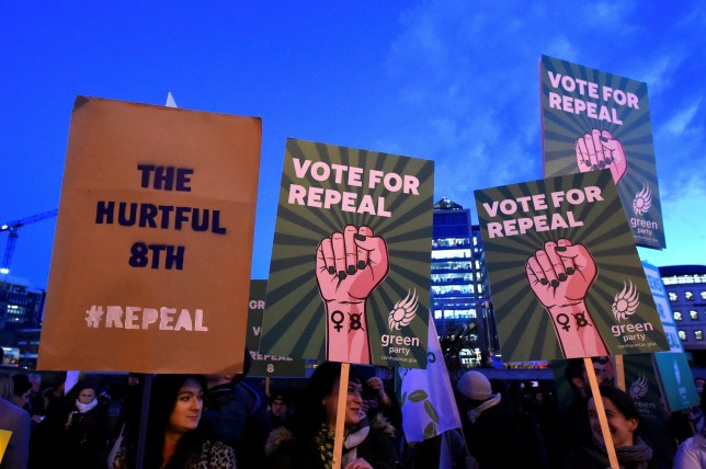 Demonstrators hold posters as they march for more liberal Irish abortion laws, in Dublin, Ireland, March 8, 2018. REUTERS/Clodagh Kilcoyne