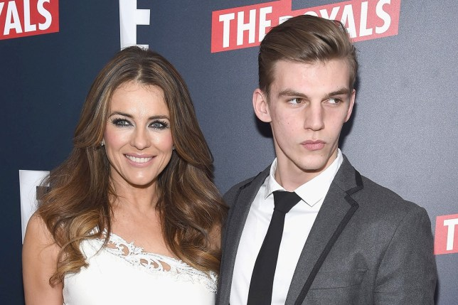 """NEW YORK, NY - MARCH 09: Actress Elizabeth Hurley and nephew, model Miles Hurley attend """"The Royals"""" New York Series Premiere at The Standard Highline on March 9, 2015 in New York City. (Photo by Gary Gershoff/WireImage)"""
