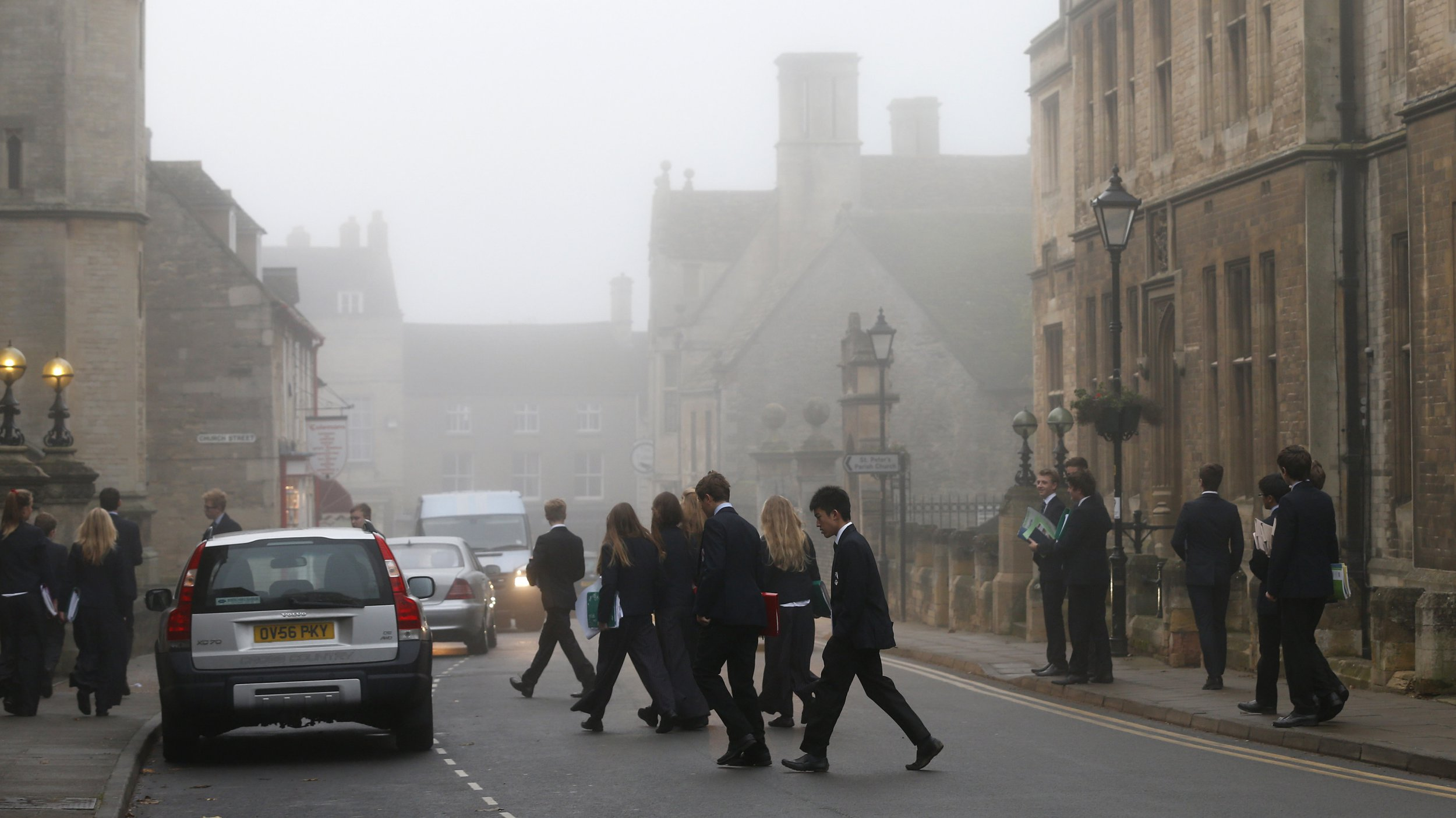 Students arrive for morning lessons at Oundle School in Oundle, near Corby, central England November 15, 2012. Britain's ruling Conservatives are expected to lose the bellwether seat of Corby in a parliamentary by-election on Thursday as voters register a protest against austerity and economic malaise. REUTERS/Eddie Keogh (BRITAIN - Tags: POLITICS ELECTIONS) - LM1E8BF0QA101