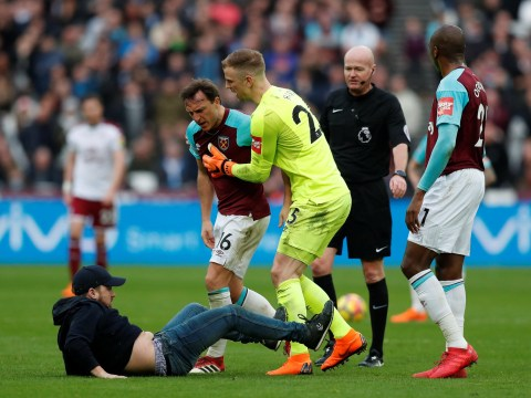 Chaos at West Ham as furious fans invade pitch and Mark Noble floors one of them