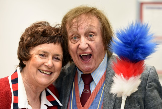 Ken Dodd salutes the news of his knighthood in the New Year's honours list with his partner Anne Jones. Photo by Colin Lane