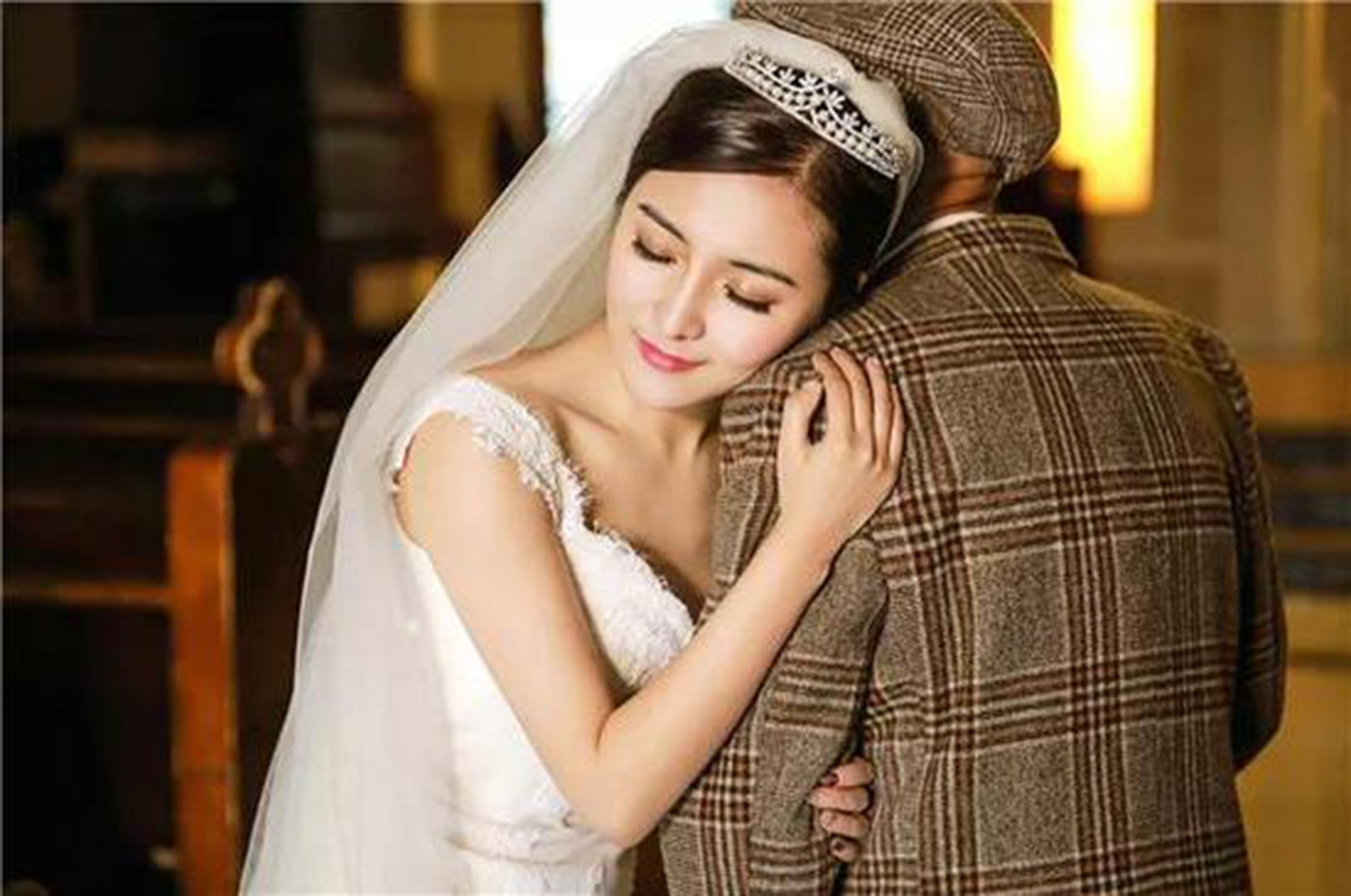 """Pic shows: The woman Fu Xuewei and her grandfather Fu Qiquan's 'wedding photos' A pretty young single woman???s decision to take wedding photos with her ailing grandad has made national headlines in China and her pictures have been shared thousands of times. The granddaughter named Fu Xuewei, who is still single, said she had to take the snaps """"before it was too late"""" - in case her beloved grandparent is taken by illness. The 25-year-old from Chengdu, capital of Sichuan Province in south-western China, wore a gorgeous white gown with a long train, while her 87-year-old grandad Fu Qiquan dressed smartly in two differently coloured suits. The photos which have gained tens of thousands of likes on social media show them inside a church as well as in a photo studio. Xuewei, who said they also played Felix Mendelssohn???s ???Wedding March??? during the shoot, later also tattooed a portrait of her grandad on her forearm. She said: """"My grandad suffered a stroke two years ago and was hospitalised again in September last year."""" """"Doctors made it clear to me that his body was failing and he has a heart condition,"""" she said, adding: """"I worried one day he suddenly won???t be here any more."""" Xuewei???s grandad essentially raised her on his own after her parents divorced while she was still a child, she said. Xuewei explained that since she has no plans to get married in the near future, she wanted to take the wedding snaps so """"the most important person"""" in her life would see her walk down the aisle in a white gown. """"I wanted him to see me at my most beautiful,"""" she said. Social media users have given the pair their blessings, with many sharing stories of the close relationships they had with their own grandfathers. (ends)"""