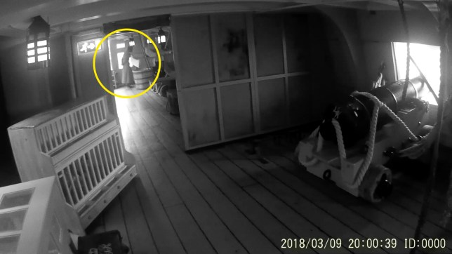 MERCURY PRESS. 15/03/18. Pictured: A screengrab from a video showing a ghostly figure HMS Victory in Portsmouth, UK. A personal trainer has captured spine-tingling footage of what he believes to be the ghost of Admiral Nelsons wife aboard the HMS Victory. In the eerie footage what appears to be the ghostly figure of a woman in a dress and heels walks through the upper chamber of the battleship - before disappearing through a wall. Tony Ferguson was enjoying a day out last week exploring the vessel, which was Lord Nelsons flagship in the Battle of Trafalgar, when he started to feel like someone - or something - was following him. The 33-year-old, who has a passion for paranormal investigation, quickly got out his video camera and panned around the chamber. SEE MERCURY COPY