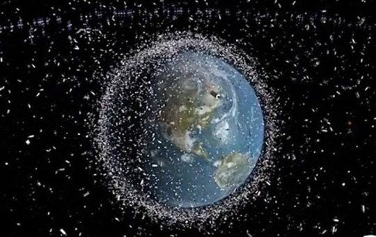 SPACE DEBRIS AROUND EARTH. More than half a century of launching into orbit has left Earth surrounded by a shroud of debris, formed of disused satellites and smaller fragments. The debris seen here is not depicted to scale, however ??? in actuality the individual elements are much tinier.