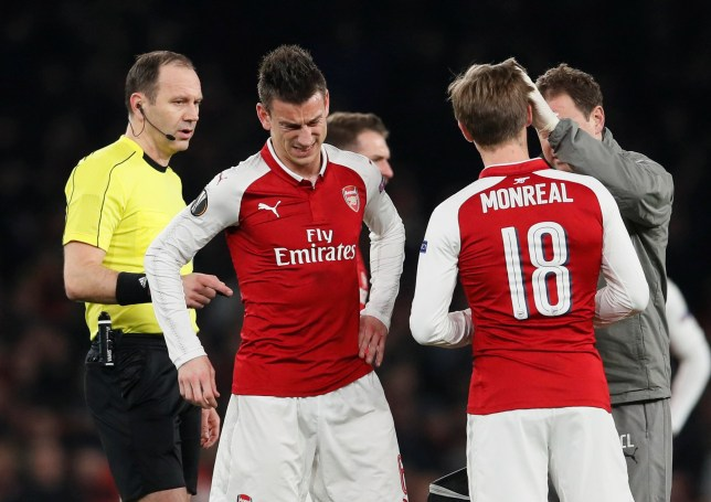 Soccer Football - Europa League Round of 16 Second Leg - Arsenal vs AC Milan - Emirates Stadium, London, Britain - March 15, 2018 Arsenal's Laurent Koscielny reacts after sustaining an injury before being substituted REUTERS/David Klein