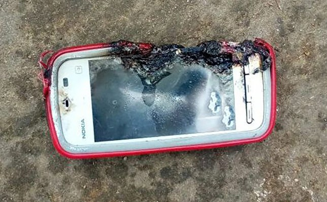 """Pic shows: Nokia 3110 model. An 18-year-old girl is said to have been killed by her Nokia phone when it exploded as she chatted on it. Victim Uma Oram is reported to have been talking on the Nokia smartphone with it plugged in to charge at home in the village of Kheriakani in the eastern Indian state of Odisha. Local media quoted her brother as saying that she had wanted to talk to an unnamed family member just after lunch but found that the phone had run out of charge. She reportedly plugged it in and was talking to the relative when the phone suddenly exploded. She reportedly received injuries to her hand, chest and leg and was knocked unconscious. Still unconscious, she was taken to hospital. Her brother Durga Prasad Oram explained: """"As the battery of the mobile phone was draining out, she plugged it for charging while talking over it simultaneously. """"The cell phone... was put on charging when she started talking to a relative. Its battery exploded suddenly. Before we could know what exactly happened, Uma fell unconscious. She was declared dead at the hospital."""" He told local media that the phone was a Nokia 3110 but some media sources said it was a Nokia 5233 smartphone. Pictures of the incident show a damaged phone that looks like the 5233, released in 2010 and Nokia???s cheapest touchscreen smartphone at the time. The 3110 was a pre-smartphone model quite unlike the one seen in pictures taken after the incident. Police have reportedly visited the scene to gather statements. Uma???s body has reportedly been sent for post-mortem. There was no comment reported from Nokia."""