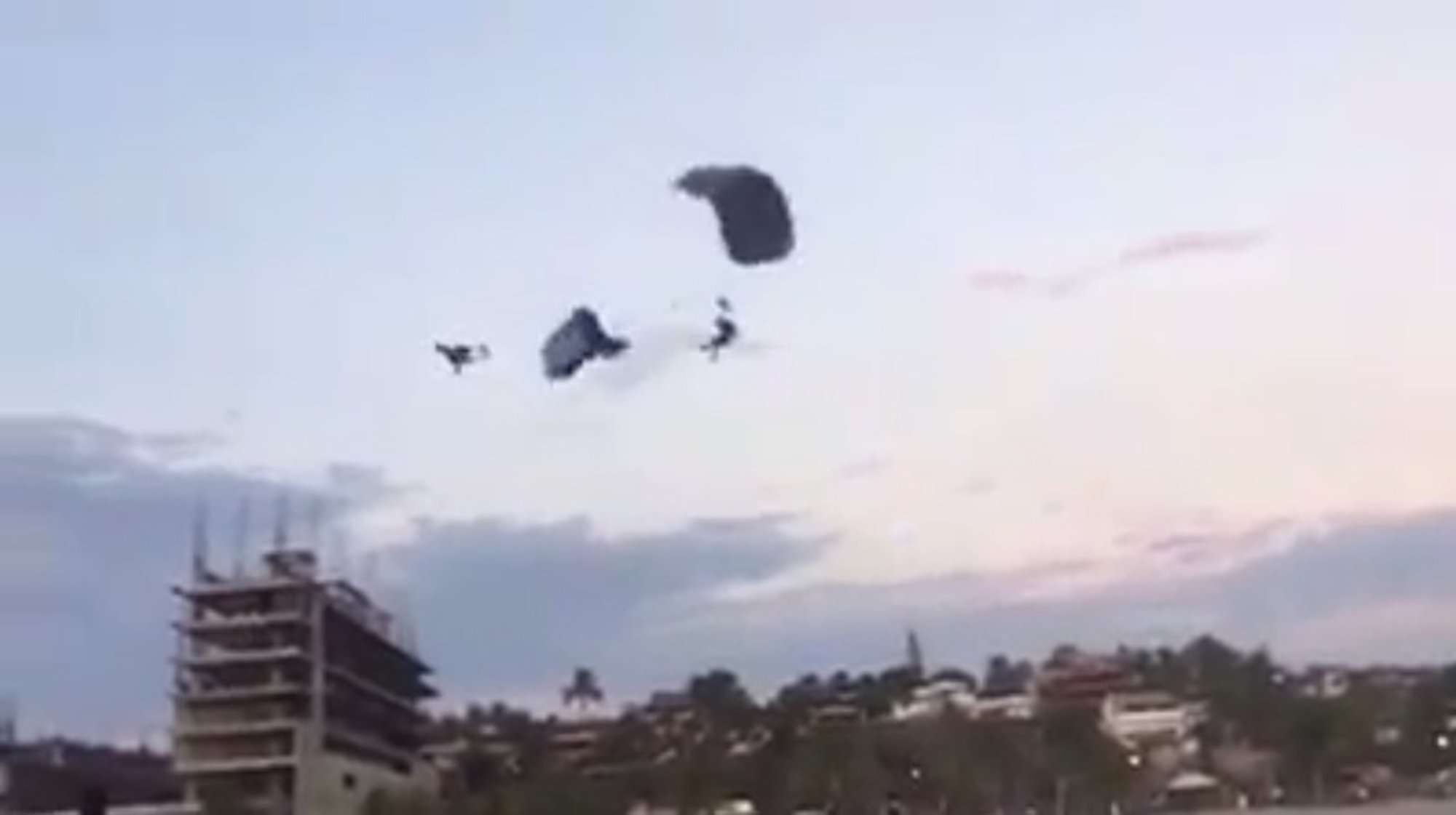 """Pic shows: The moment the two parachutists collide in mid-air. A tourist has died after two parachutists collided in mid-air and one was sent hurtling to the ground below. In video footage of the shocking accident, two parachutists are seen gliding through the air as they come in to land on a popular tourist beach in Puerto Escondido, a resort on Mexico???s Pacific coast in the state of Oaxaca. The 43-year-old woman, identified as Ursula, is seen gliding across the screen from right to left. Slightly above her, coming in from the opposite side, is another parachutist who accidentally crashes into the woman???s parachute. The impact flattens the woman???s parachute, making her drop from the sky like a stone. The parachute did not have enough time to right itself and the middle-aged tourist from Mexico City hit the beach below. According to local media, the woman was rushed to a medical centre where she later succumbed to her injuries. The victim???s family has accused the company Skydive Puerto Escondido of lack of safety and for disassociating itself from the accident. Family members said that tourists """"have to sign a non-liability disclosure that removes the company from all responsibility"""". The video has been widely circulated by social and local media and netizens were shocked by the footage. ???AlejandroMeza??? said: """"It is incredible that these services do not have safety procedures in place to prevent this kind of thing from happening. """"Even if they sign a non-liability form, the authorities should investigate the company responsible, because it is obvious that these tourists had no control over what they were doing."""" (ends)"""
