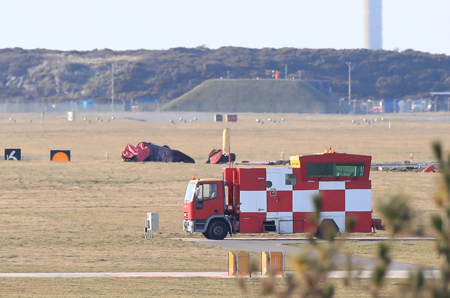 Wreckage after a Red Arrows jet crashed at RAF Valley in north Wales. PRESS ASSOCIATION Photo. Picture date: Tuesday March 20, 2018. It is understood there were two people on board the Red Arrows jet aircraft which crashed on Tuesday. See PA story DEFENCE RedArrow. Photo credit should read: Peter Byrne/PA Wire