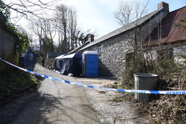 Hoarder lived with mum's dead body buried under mountain of