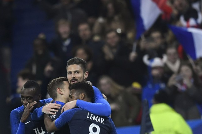 France's forward Olivier Giroud (C) celebrates with teammates after scoring a goal during the friendly football match between France and Colombia at the Stade de France, in Saint-Denis, on the outskirts of Paris, on March 23, 2018. / AFP PHOTO / CHRISTOPHE SIMONCHRISTOPHE SIMON/AFP/Getty Images