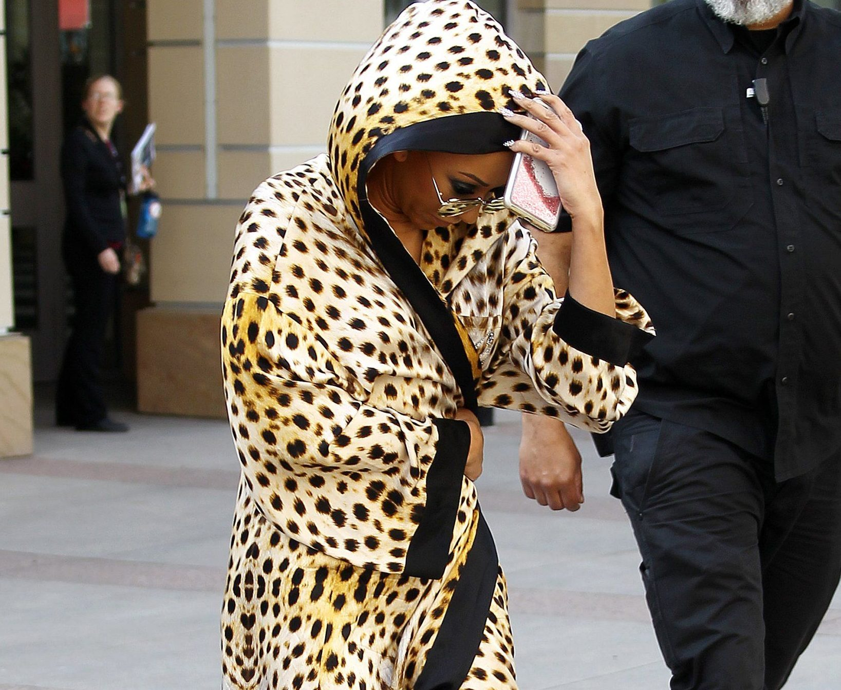 "Mel B wears a cheetah print robe with the words ""SCARY SPICE MEL B"" printed on the back"