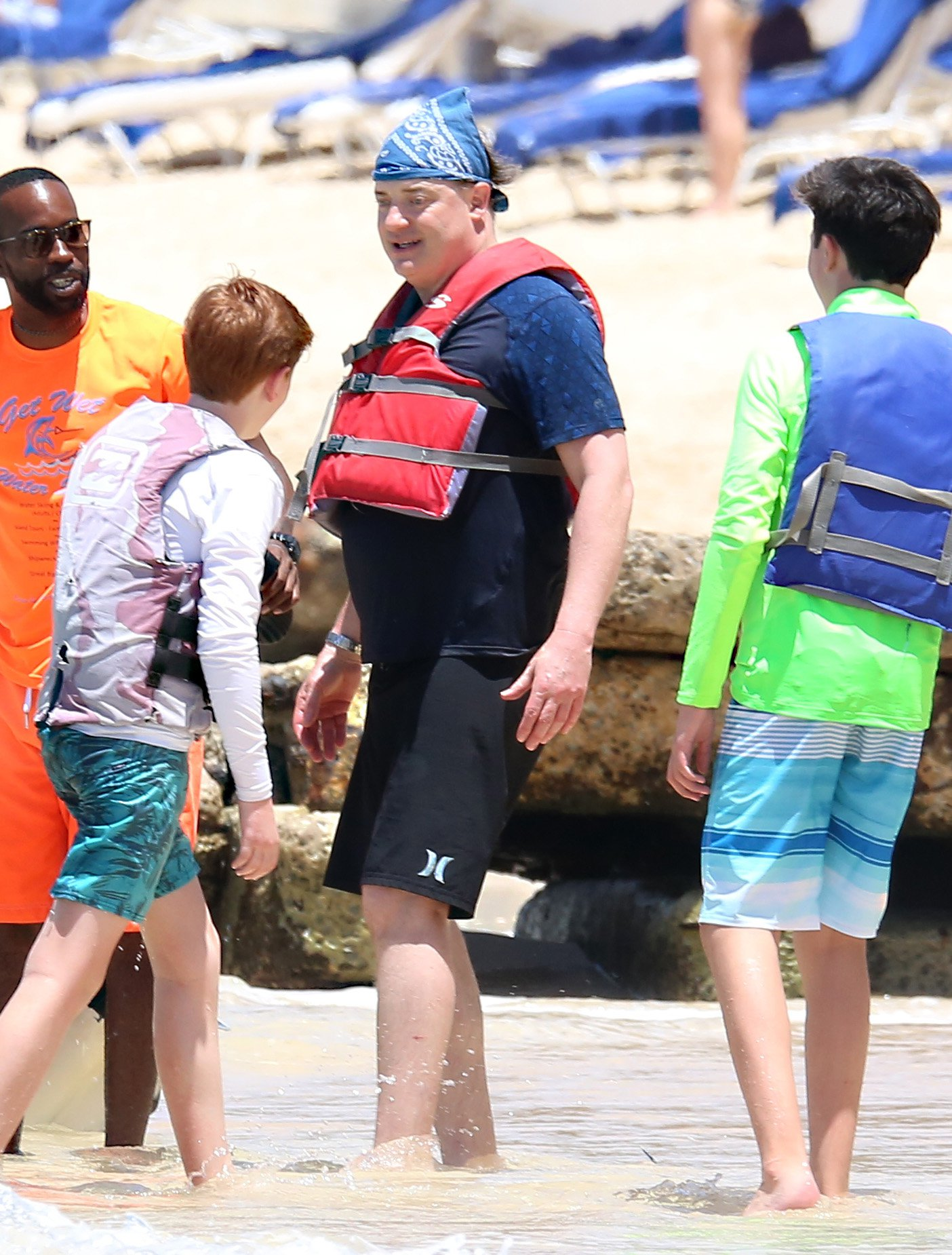 Brendan Fraser covers up from head to toe as he enjoys an inflatable ride with sons at the beach in Barbados. 23 Mar 2018 Pictured: Brendan Fraser. Photo credit: MEGA TheMegaAgency.com +1 888 505 6342