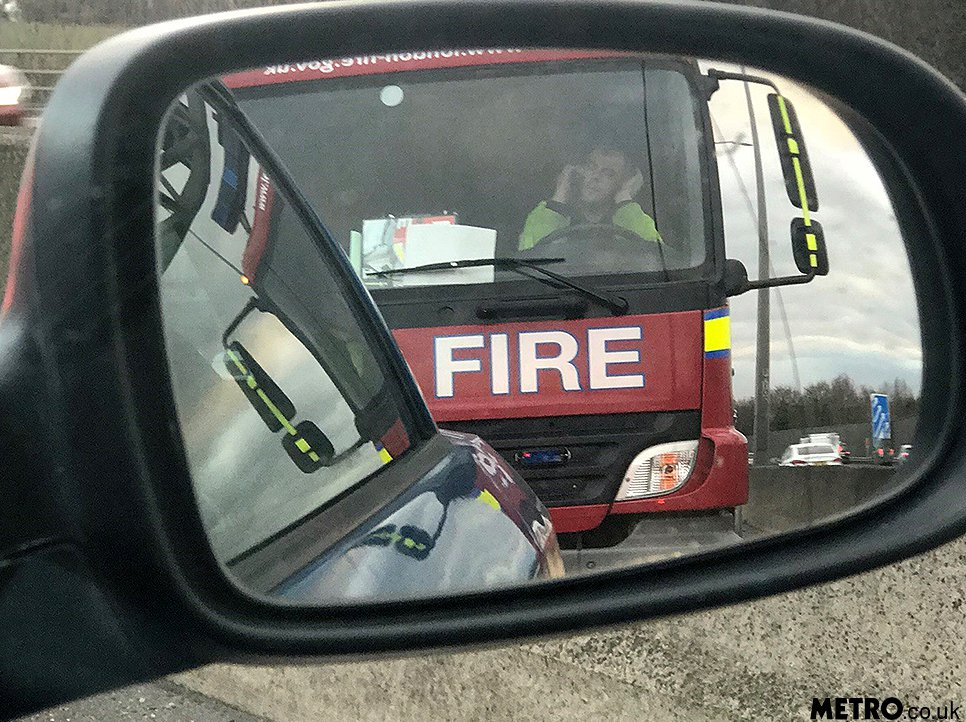 Firefighter 'filmed using phone on M25' picture: supplied METRO.CO.UK CROP
