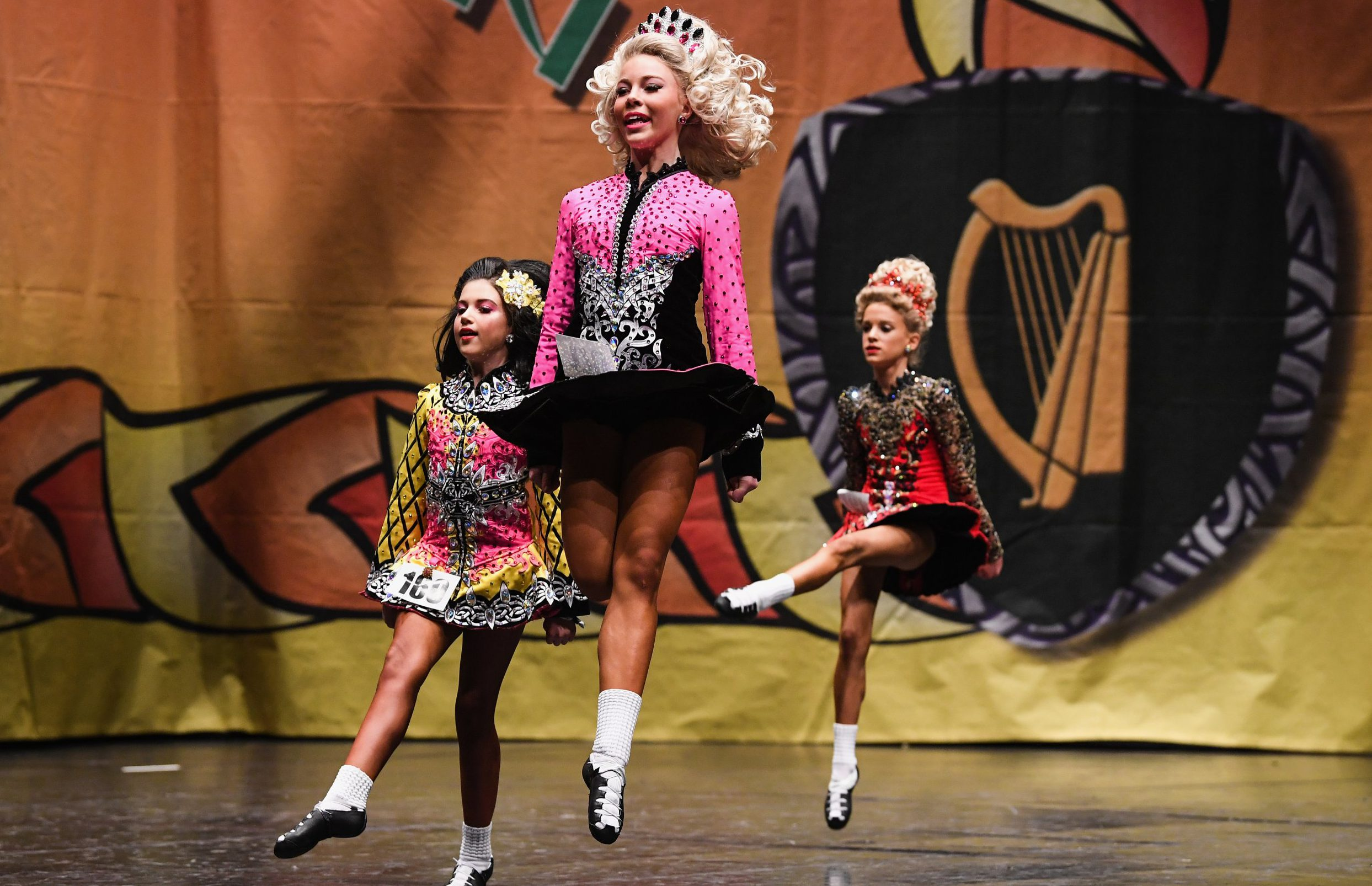 GLASGOW, SCOTLAND - MARCH 25: Competitors take part in the World Irish Dancing Championships on March 25, 2018 in Glasgow, Scotland. The World Irish Dancing Championships are taking place in Glasgow this week at the Royal Concert Hall, with more than 14,500 dancers and supporters expected to travel to the championships which has run for more than forty years. (Photo by Jeff J Mitchell/Getty Images)