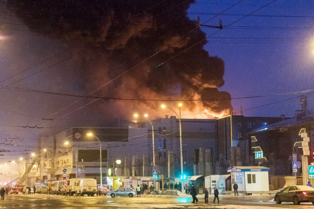 KEMEROVO, RUSSIA - MARCH 25, 2018: Battling a fire at the Zimnyaya Vishnya shopping centre in Prospekt Lenina Street; several people and at least four children have been killed in the fire. Danil Aikin/TASS (Photo by Danil Aikin\TASS via Getty Images)