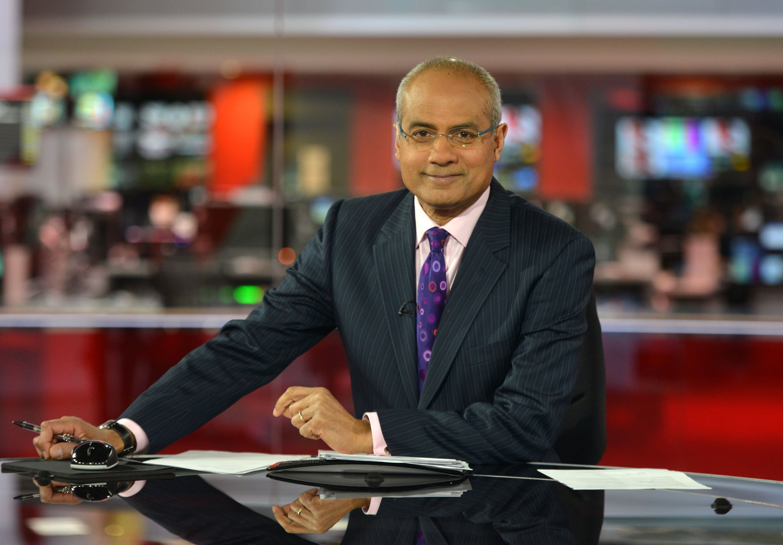 """For use in UK, Ireland or Benelux countries only Undated BBC handout photo of BBC newsreader George Alagiah, who said his cancer was caught """"very late"""" and may have been detected earlier if England had similar screening procedures to Scotland. PRESS ASSOCIATION Photo. Issue date: Sunday March 25, 2018. The 62-year-old presenter, who lives in London, discovered his stage four bowel cancer had returned before Christmas. See PA story HEALTH Alagiah. Photo credit should read: Jeff Overs/BBC/PA Wire NOTE TO EDITORS: Not for use more than 21 days after issue. You may use this picture without charge only for the purpose of publicising or reporting on current BBC programming, personnel or other BBC output or activity within 21 days of issue. Any use after that time MUST be cleared through BBC Picture Publicity. Please credit the image to the BBC and any named photographer or independent programme maker, as described in the caption."""