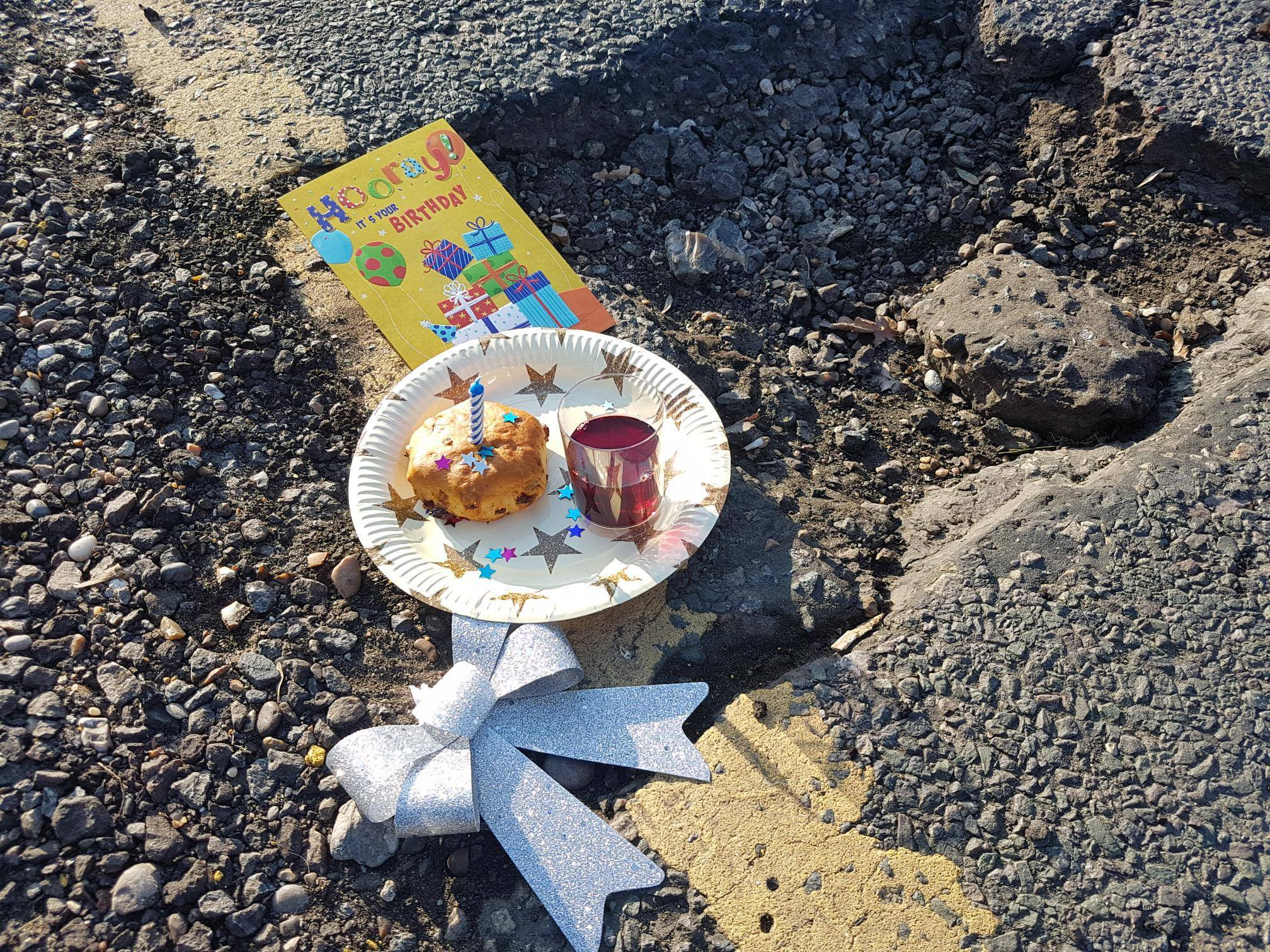People hold first birthday party for pothole Picture: Paul Gibson METROGRAB