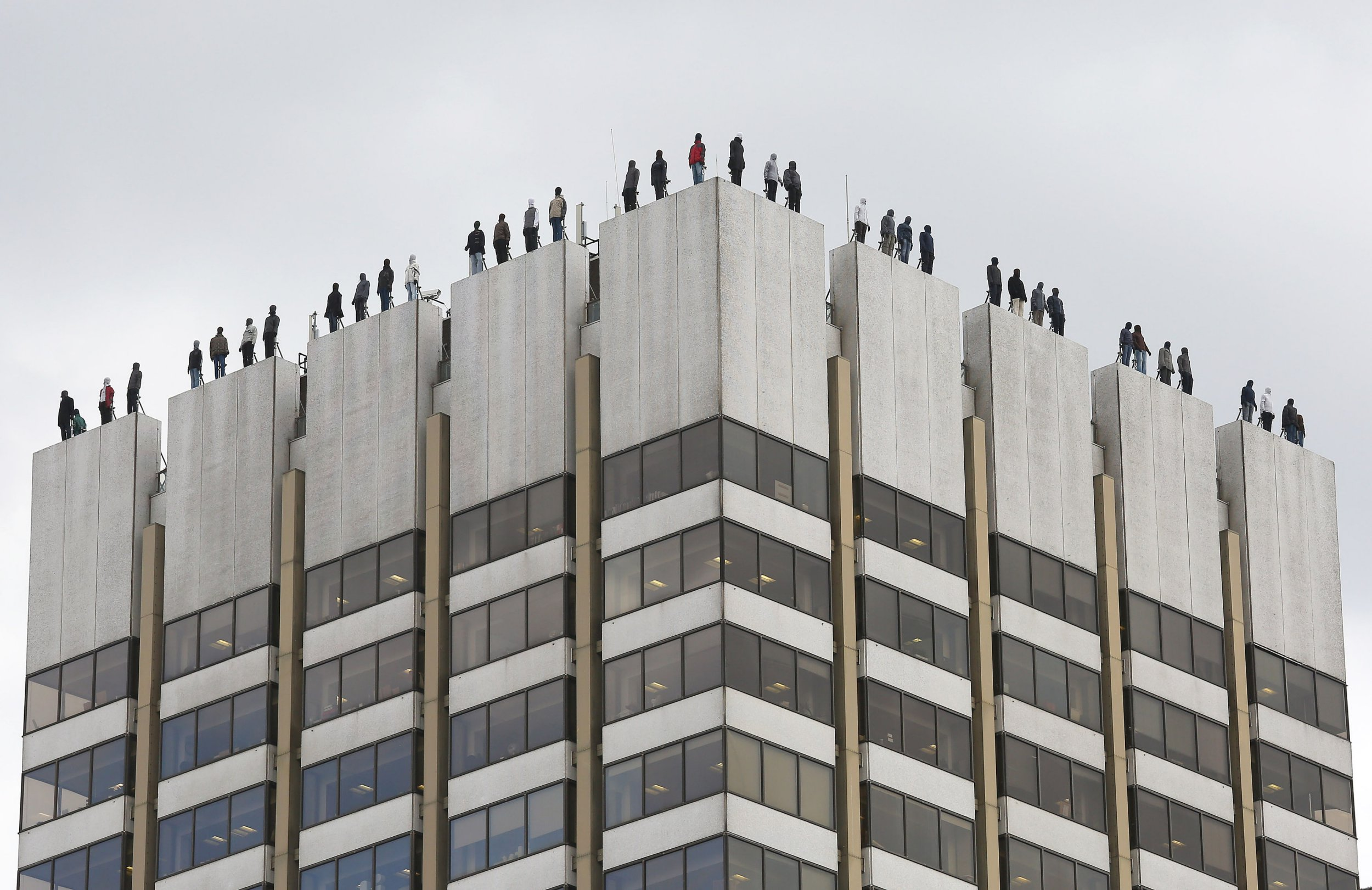 The sculptures of 84 men, made by American artist Mark Jenkins and his collaborator, Sandra Fernandez, part of Project 84, a campaign to raise awareness of the fact that 84 men take their own lives every week in the UK, ontop of London Television Centre after the installation was unveiled. PRESS ASSOCIATION Photo. Picture date: Monday March 26, 2018. See PA story SHOWBIZ Morning. Photo credit should read: Philip Toscano/PA Wire