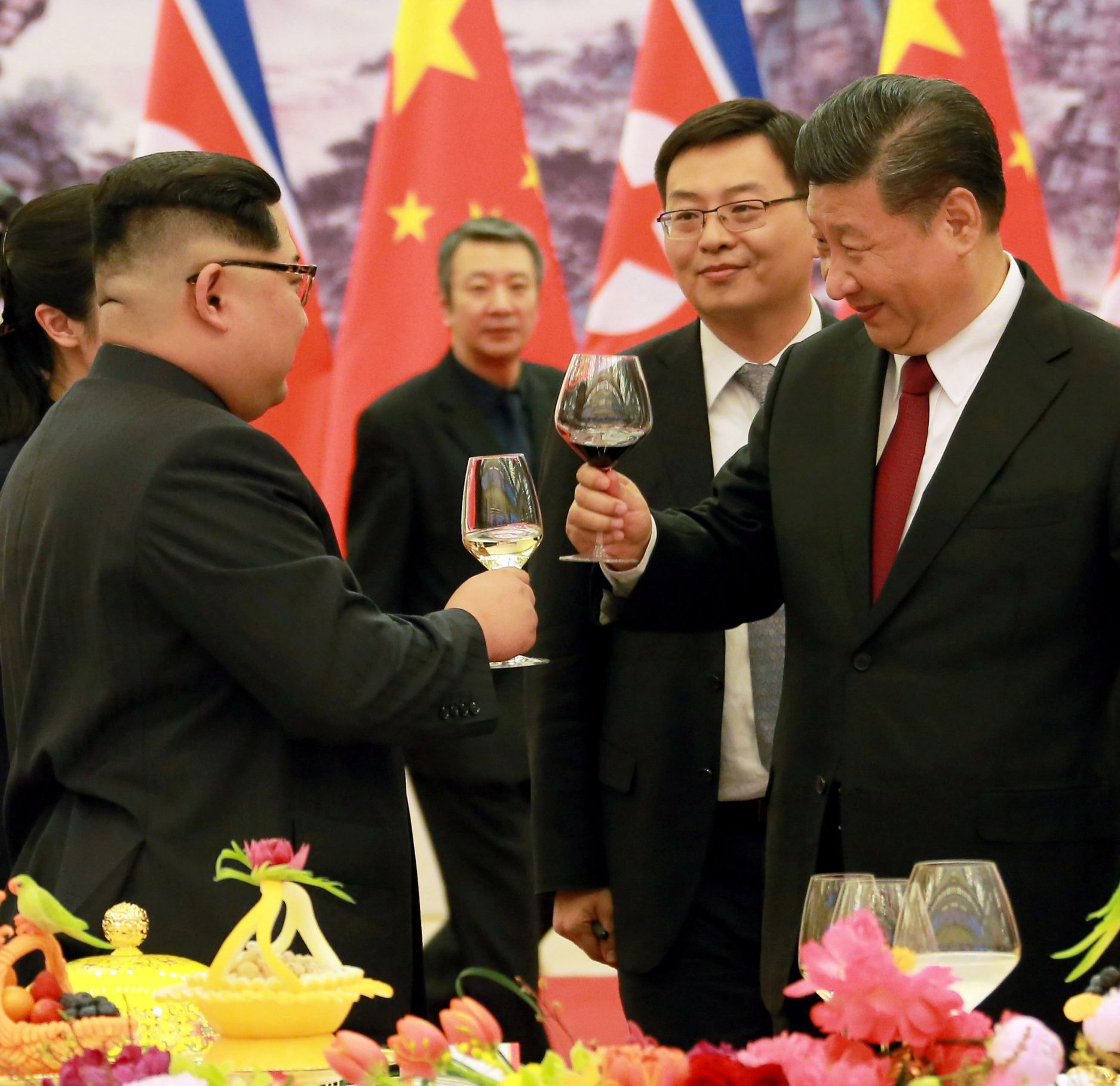 REFILE - ADDING CITY North Korean leader Kim Jong Un toasts with Chinese President Xi Jinping, as he paid an unofficial visit to Beijing, China, in this undated photo released by North Korea's Korean Central News Agency (KCNA) in Pyongyang March 28,2018. KCNA/via Reuters ATTENTION EDITORS - THIS IMAGE WAS PROVIDED BY A THIRD PARTY. REUTERS IS UNABLE TO INDEPENDENTLY VERIFY THIS IMAGE. NO THIRD PARTY SALES. NOT FOR USE BY REUTERS THIRD PARTY DISTRIBUTORS. SOUTH KOREA OUT. NO COMMERCIAL OR EDITORIAL SALES IN SOUTH KOREA.