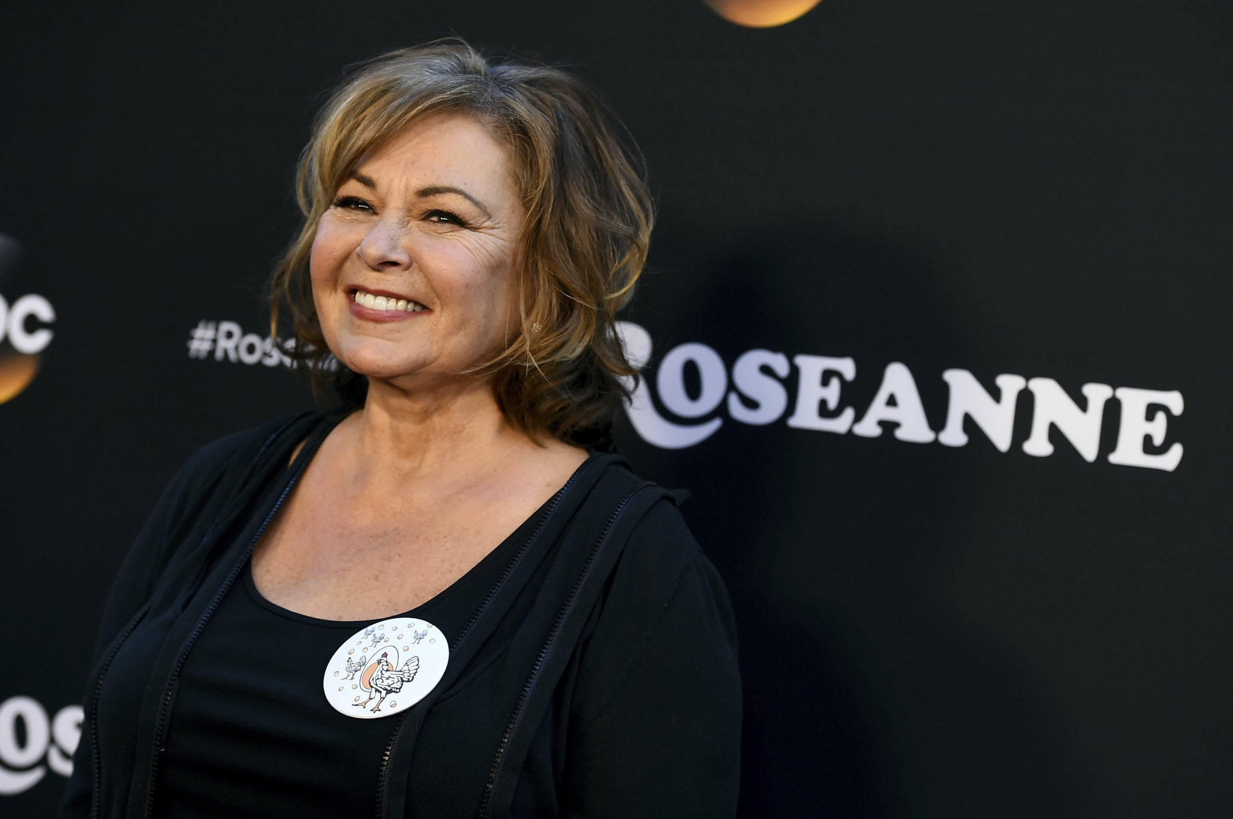 """FILE - In this March 23, 2018, file photo, Roseanne Barr arrives at the Los Angeles premiere of """"Roseanne"""" on Friday in Burbank, Calif. President Donald Trump called Barr after an estimated 18.4 million viewers tuned in for the reboot of """"Roseanne."""" Speaking by telephone on ABC???s ???Good Morning America??? Thursday, March 29, Barr said Wednesday night???s call was pretty exciting. (Photo by Jordan Strauss/Invision/AP, File)"""