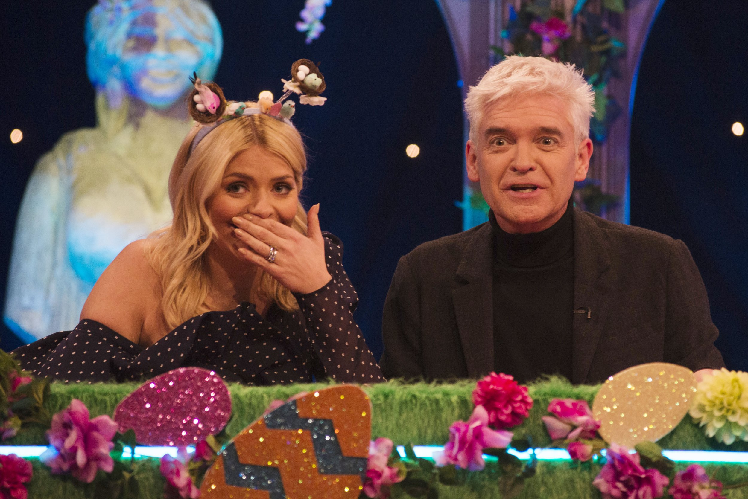 From Talkback Thames Celebrity Juice: SR19: Ep2: Easter Special on ITV2 Pictured: Holly Willoughby and Phillip Schofield. This photograph is (C) Talkback Thames and can only be reproduced for editorial purposes directly in connection with the programme or event mentioned above or ITV plc. Once made available by ITV plc Picture Desk, this photograph can be reproduced once only up until the transmission [TX] date and no reproduction fee will be charged. Any subsequent usage may incur a fee. This photograph must not be manipulated [excluding basic cropping] in a manner which alters the visual appearance of the person photographed deemed detrimental or inappropriate by ITV plc Picture Desk. This photograph must not be syndicated to any other company, publication or website, or permanently archived, without the express written permission of ITV Plc Picture Desk. Full Terms and conditions are available on the website www.itvpictures.com For further information please contact: james.hilder@itv.com / 0207 157 3052