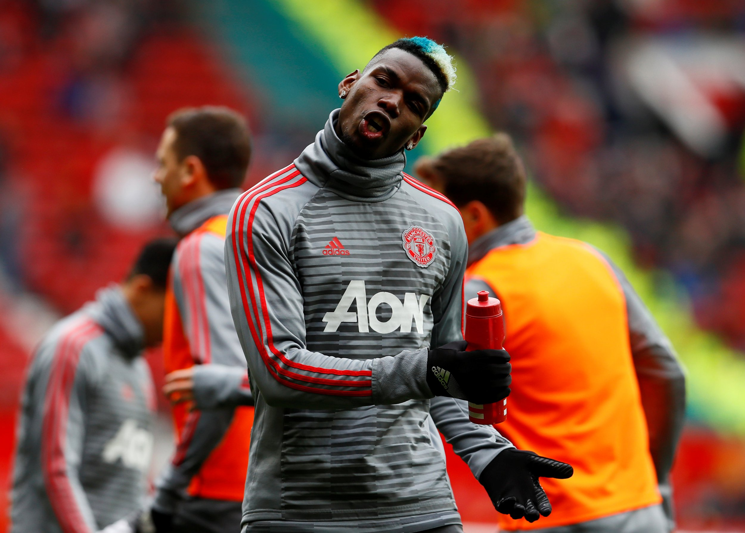 "Soccer Football - Premier League - Manchester United vs Swansea City - Old Trafford, Manchester, Britain - March 31, 2018 Manchester United's Paul Pogba during the warm up before the match Action Images via Reuters/Jason Cairnduff EDITORIAL USE ONLY. No use with unauthorized audio, video, data, fixture lists, club/league logos or ""live"" services. Online in-match use limited to 75 images, no video emulation. No use in betting, games or single club/league/player publications. Please contact your account representative for further details."