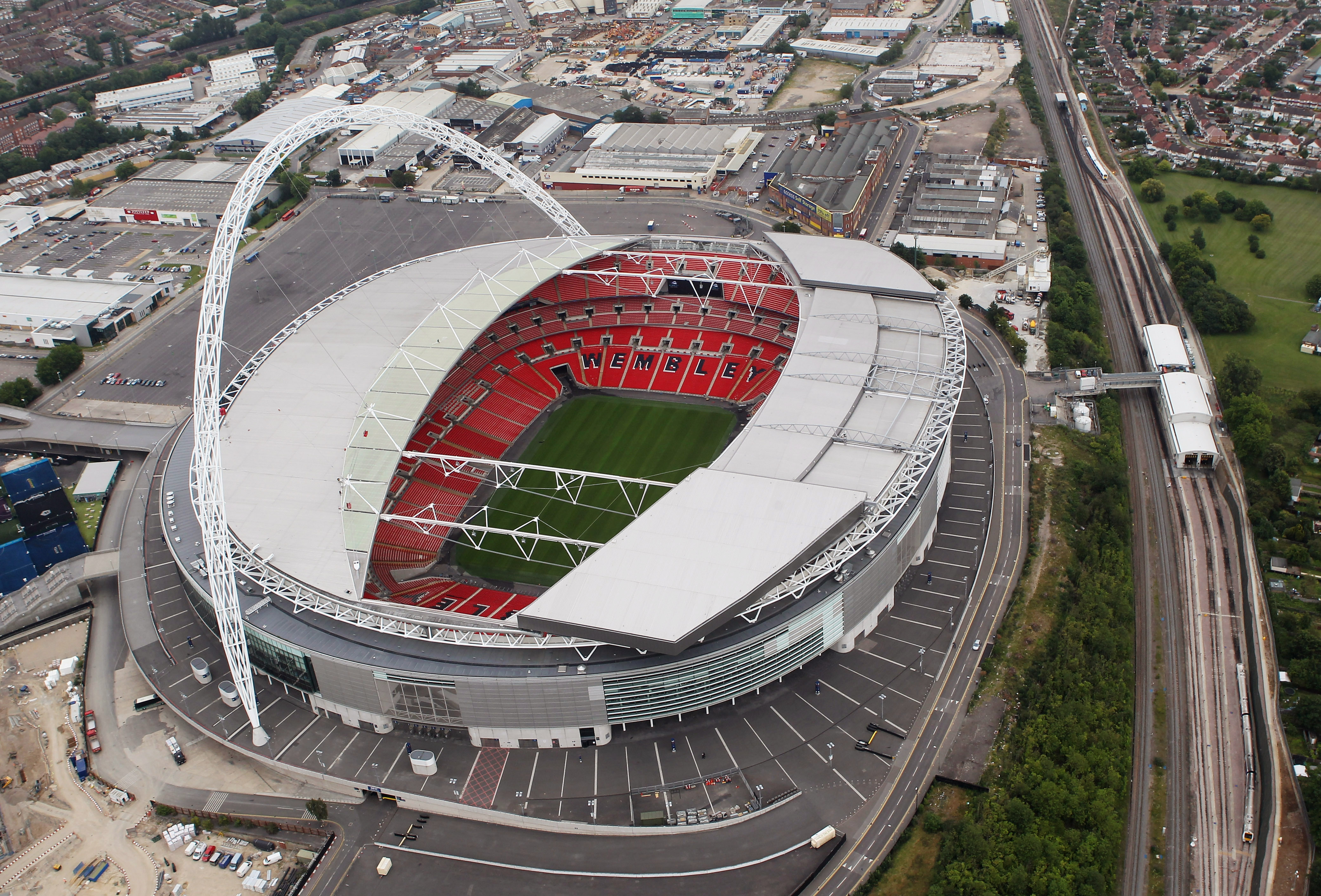 How much did Wembley Stadium cost and who owns it?