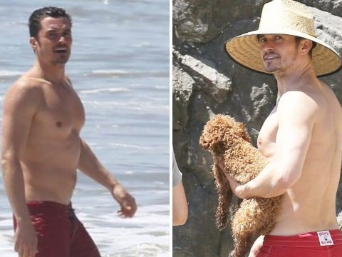 Orlando Bloom covers up for beach day with his dog and it's sweet