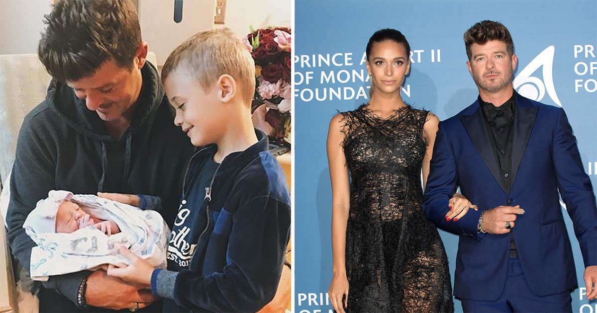 Robin Thicke's son Julian looks smitten as he meets newborn sister after singer welcomes second child
