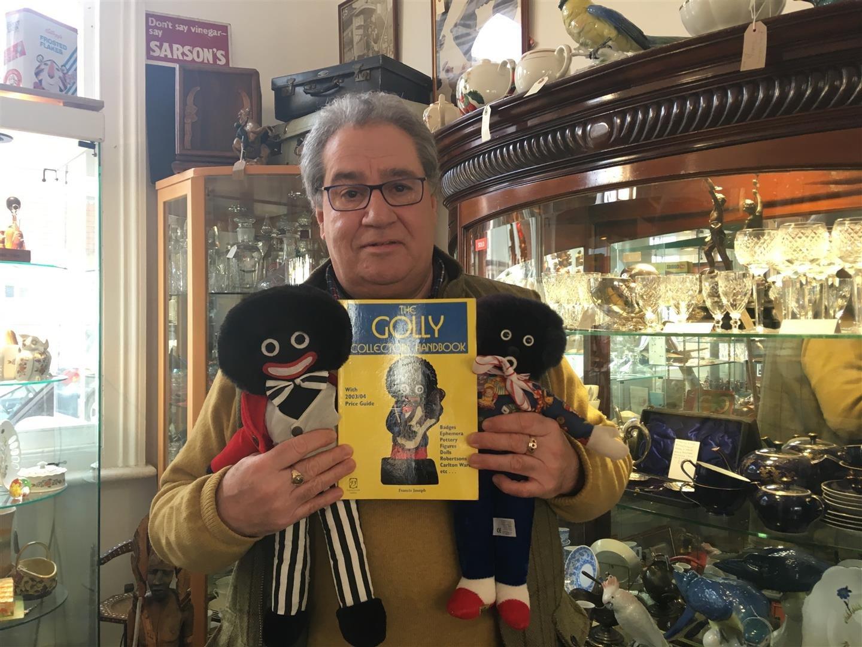 Shop owner refuses to stop selling golliwog dolls despite complaints