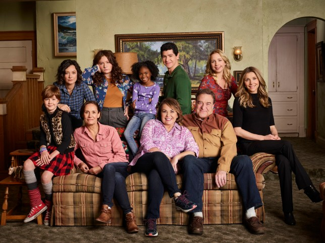 "ROSEANNE - ABC's ""Roseanne"" stars Ames McNamara as Mark, Sara Gilbert as Darlene Conner, Laurie Metcalf as Jackie Harris, Emma Kenney as Harris Conner, Jayden Rey as Mary, Roseanne Barr as Roseanne Conner, Michael Fishman as D.J. Conner, John Goodman as Dan Conner, Lecy Goranson as Becky Conner, and Sarah Chalke as Andrea. (Robert Trachtenberg/ABC via Getty Images)"