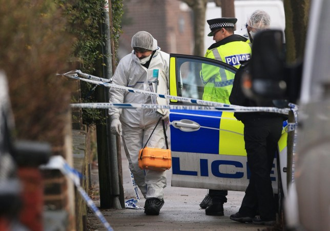 File photo dated 10/01/18 of a forensics officer at the scene of an investigation at Matlock Road in Reddish on the outskirts of Manchester. Barbara Coombes, whose father has been missing for years, has been charged with murder after telling police she had killed a man and buried his body in her back garden.