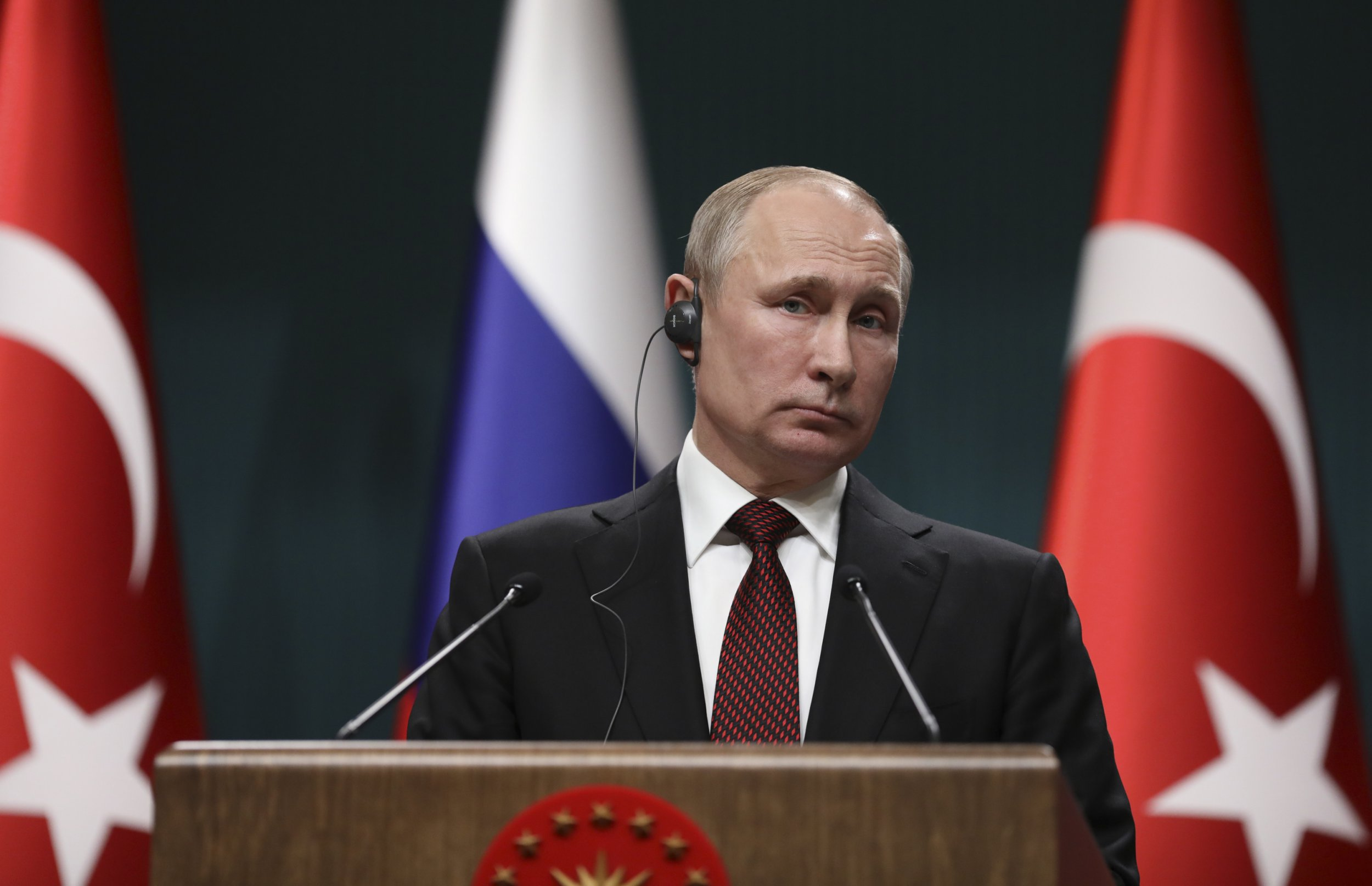 Russia's President Vladimir Putin, listens to a reporter's question during a joint news conference with Turkey's President Recep Tayyip Erdogan, following their meeting at the Presidential Palace in Ankara, Turkey, Tuesday, April 3, 2018. Russian President Vladimir Putin, on his first foreign visit since being re-elected on March 18, and Erdogan remotely gave the go-ahead for the construction of the Russian-built nuclear plant on the Mediterranean coast at Akkuyu, Turkey, as ties between the two nations deepen. (AP Photo/Burhan Ozbilici)