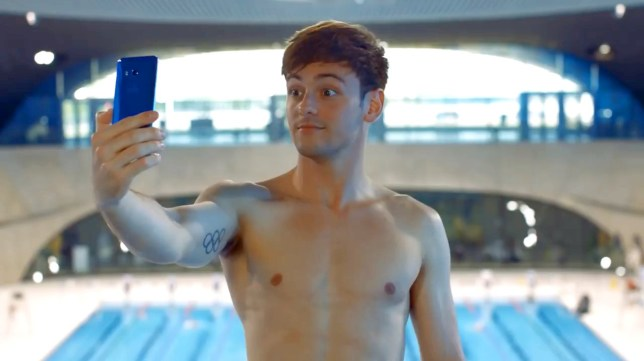 (Picture: YouTube) An ad for an HTC mobile phone featuring champion diver Tom Daley has been banned for implying that the device can be used in swimming pools. A Facebook post for HTC U11 seen on December 7 showed Daley using the phone to take selfies while diving from a board and landing into the swimming pool below with the phone in his hand submerged in the water. A complainant, who noted that the instructions for the phone stated that it was water resistant in fresh water, challenged whether the ad misleadingly implied the product would work in a pool with chlorinated water.